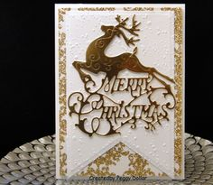 Christmas 2016 Gina Marie Designs Merry Christmas die. Snowfall EF Glitter Gold and white dp. Created by Peggy Dollar