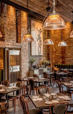 """The Assembly Design Studio designers of Ledger, a local restaurant and bar on New England's North Shore, envisioned a """"rough restoration"""" of the historic Salem Savings Bank — a place where customers…"""