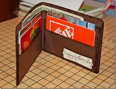 Handmade paper wallet filled with gift cards, cash, and a pic of the kids for a cool Father's Day gift.