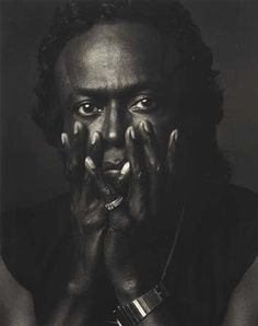 Heroes + Other One-of-a-Kinds...........  Miles by Annie Leibowitz.  This hangs in my office