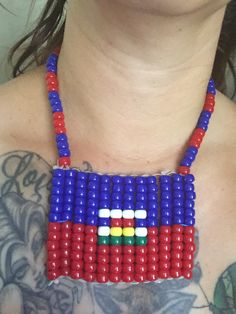 A personal favorite from my Etsy shop https://www.etsy.com/listing/458587348/haitian-pride-giant-flag-necklace