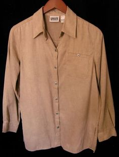 """This is a gently worn Chico's designer tan long sleeve casual career comfortable L Women's Top Blouse. This top looks new. The tag says this is a Chico's size 0. This is not a small top. The measurements when laid flat are 20"""" or 40"""" bust, the waist is 20"""" or 40"""", the bottom is 20"""" or 40"""". This is a large top."""