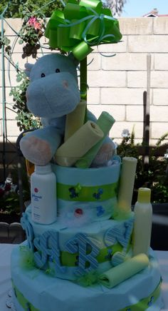 Baby boy diaper cake filled with Pamper's diapers and baby products. Used as a center piece for a baby shower.