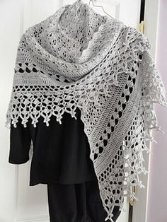 Jenny's Faith - Wide triangular lace shawl worked in two parts. Body of shawl is worked from apex to neck edge. Diamond Panel and lace edging are worked in rows down each side of shawl from corner to corner.