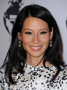 Asian brides can look to Lucy Liu for their makeup style. Love the rose coloured gloss and cheeks and her eyes look amazing with black lashes and liner.
