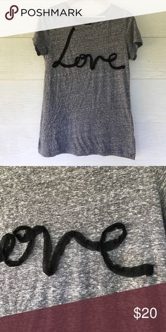 LOVE American Eagle tshirt Size xl. LOVE is written in black ribbon on front. Back is solid. Gray short sleeve tshirt. 20 bust 26 length.  All measurements are approximate American Eagle Outfitters Tops Tees - Short Sleeve