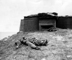 The corpse of a German soldier outside his bunker  on Utah Beach, 6 June 1944.