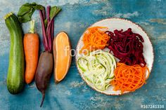 """Zucchini, carrot, sweet potato and beetroot noodles on a plate. Top view, overhead, copy space. Blue rustic background"" Stockfotos und lizenzfreie Bilder auf Fotolia.com - Bild 167241318"
