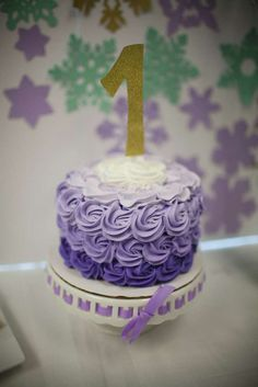 Purple ombre cake at a Winter Wonderland birthday party! See more party ideas at CatchMyParty.com!