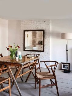 Eating space. White brick. Wood chairs.