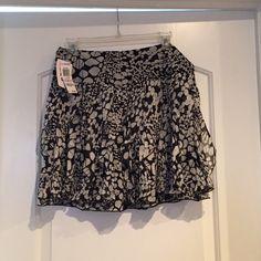 Black and white skirt. Nostalgia butterfly dot pattern. Black and white skirt. 100% silk. With zipper in back. Nostalgia Skirts