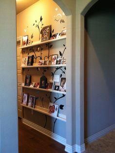 I love you Pinterest . DIY wall shelves/gallery - idea straight off of Pinterest . I added the tree wall decal on first then the shelves right over