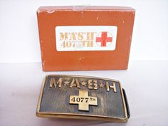 MASH SOLID BRASS BUCKLE - FOX FILM CORP 1981 Possibly one of 100 buckles made by a member of the M*A*S*H production crew and given as a gift to the rest of the crew as well as the cast. approx size x Includes original box Mash 4077, Brass Buckle, Medicine Cabinet, Solid Brass, Fox, It Cast, The Originals, Gifts, Etsy