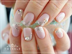 Pink nails with silver glitter accents