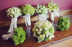 single type of flower for each bridesmaids with each one incorporated in bridal bouquet
