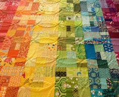 I love the double wedding ring quilting on a top not patched in DWR blocks. I love the symbolism too of a DWR quilt in rainbow colors. :)
