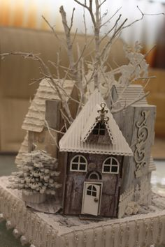 little houses... the pine trees look like they could be good inspiration for a 3d stacked quilling idea