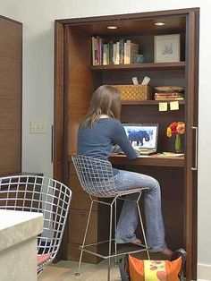 When former mudroom space was merged with the kitchen, it became a spot to put a desk with the family computer. The homeowners love the convenience of a desk in the kitchen -- and the ability to hide it simply by shutting the doors./