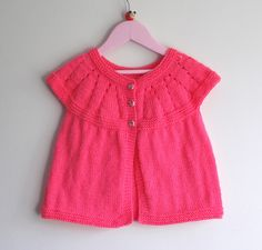 This pattern for an All-in-One Sleeveless Knit Top expands one of our readers' all-time favorite knit patterns into larger sizes. This free knitting pattern provides you with two extended sizes for this knit sleeveless top. Kids Knitting Patterns, Baby Cardigan Knitting Pattern, Knitted Baby Cardigan, Knitting For Kids, Free Knitting, Crochet Patterns, Top Pattern, Pattern Design, Free Pattern
