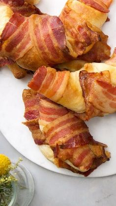 When a normal croissant isn't sufficient, stuff it with cheesy scrambled eggs and wrap it in crispy bacon.