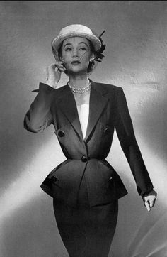1951 Sophie Malgat in elegant black alpaca suit over deep rose silk blouse lined in same deep rose by Paquin, photo by Georges Saad