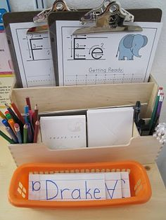 Writing center. Have class names in a basket. (I like the clipboards.)