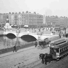 O'Connell Bridge View of O'Connell from Aston Quay with a horse-drawn tram in the foreground. © Courtesy of The National Library of Ireland Ireland Pictures, Images Of Ireland, Old Pictures, Old Photos, Vintage Photos, Vintage Photographs, Dublin Street, Dublin City, Irish Independence