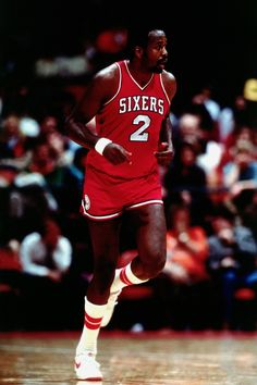 Moses Malone, , who played for the Philadelphia 76ers from 1982 to 1986 and 1993 to 1994.
