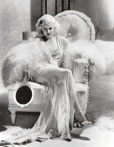 Jean Harlow was not only a private client of Syrie Maughams, S.M. also decorated the set of her movie Dinner at Eight.  Eleven shades of white were needed to create enough contrast for the black and white film.  Notice the fringe on the chair?  A hallmark of Maughams style.