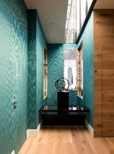 Industrial chic luxury loft apartment hallway wall paneling plywood blue turquoise