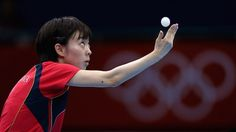 Kasumi Ishikawa of Japan serves in her Women's Singles Table Tennis third round match against Li Qiangbing of Austria on Day 2.