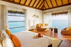 Great Interior Design to Enjoy the Earth Paradise in Velassaru: The Bedroom With Brown Hat Of Velassaru Resort