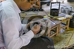 The man at the time of painting a dish from bamboo in the factory  Bagan , Myanmar (Burma)