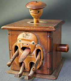 Kobe Toy Tin-Automata Wooden Automaton figure with inlaid bone eyes a