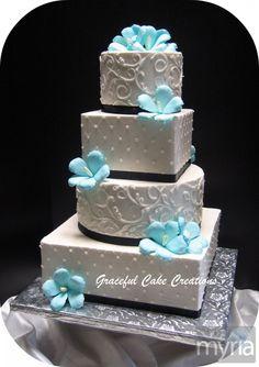 Tropical blue hibiscus wedding cake