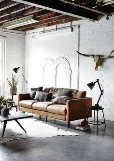 For a classic look that never gets old, choose a leather sofa in rustic tan. We…