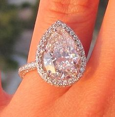 gorgeous 5.59 carat, pear shape micro-pave band ring.