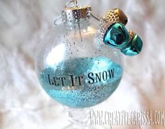 Make Easy Glittered Bulb Ornaments ~ These ornaments are quick and easy to make and are a great project to do with kids or beginning crafters (the blue ornament in the photo was made by a nine year old girl!). Really, I'm not sure if you could design a better project: quick, easy and affordable