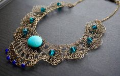 Statement necklace. A bib statement necklace crocheted with copper wire and with added turquoise and glass beads.