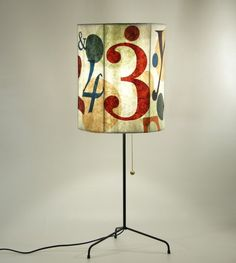 How pretty is this numbers lamp!  Illuminate a room with this modern lampshade from Laura Lights! You could COUNT on it to add some personality to your space.