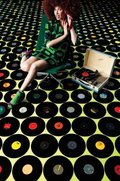 Clear poured flooring that allows you to 'capture' objects (in this case, vinyl records - but I've seen coins as well)