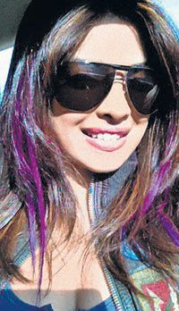 Purple streaks in dark brown hair.