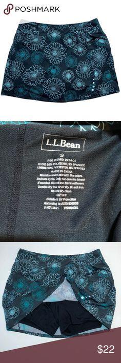 985490ab4a11a L.L. Bean athletic skirt skort gray floral pocket L.L. Bean athletic skort.  Gray with blue flower print. Has a zipper on the side.