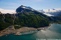 Whittier, Alaska. Getting to this small town is half the fun! You must drive through a long one-way railroad tunnel at the designated time to avoid running into oncoming traffic or a train. Once there you can take the fantastic 26 Glacier cruise through Prince William Sound.