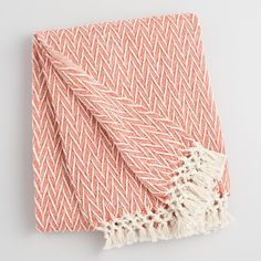 $24 Crafted of woven cotton with a subtle chevron pattern and handsome knotted fringe, our chili orange and ivory throw brings natural warmth and style to any sitting space.