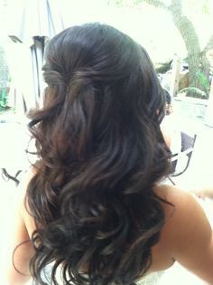 Clip-in extensions half up curled