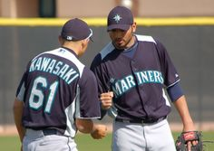 Non-roster ST pitching candidate Jeff Marquez teaching Kawasaki an elaborate handshake. Mariners.