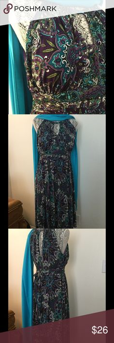 Beautiful Multi-color halter top dress. R&K Practically New shades of purple, shades of turquoise, green, and white. Attached tie in back fabric belt. Zipper in back. Fits great! R&K Dresses Midi