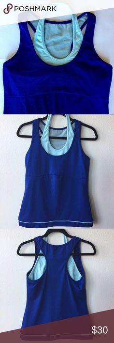 """Lucy Halter Tank Top Royal Blue Medium Lucy Activewear. Size Medium. Retail: $69. Royal blue tank top body with built-in light blue halter bra. Supportive, double-lined mesh breathable bra inside. Seaming under bust for flattering fit. Light blue piping along bottom seam for decorative flair. Fully lined body. Rip-out tag has been removed. Chest laying flat: 16.5"""". Shoulder-to-hem length: 24"""". Perfect, like-new condition. No signs of wear. 🛍20% Off Bundles of 2+ Items! Lucy Tops Tank Tops"""