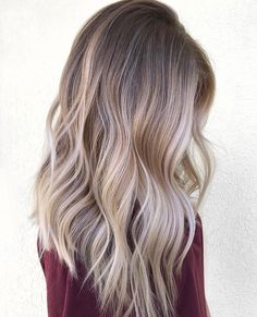 Beautiful ashy balayage with a level 7 root blending into gorgeous platinum, buttery blonde to create the most perfect contrast in color.